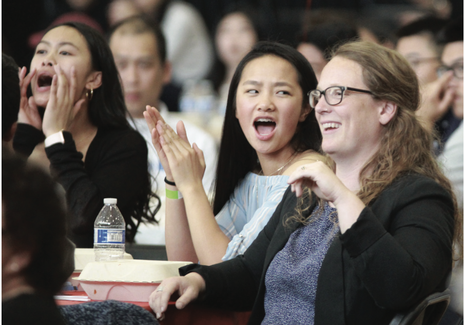 Softball players Vicki Ly, left, Fiona Clayton and head coach Rebecca Williams Leach cheer after their team is announced as a nominee for Team of the Year.