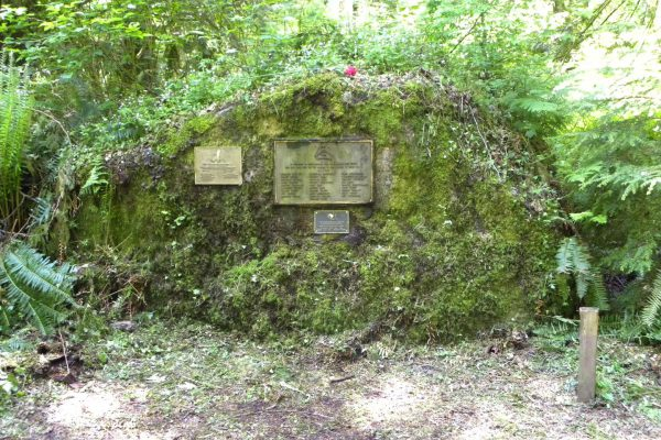 Three brass plaques installed on a large, flat rock in the Cleveland High School Memorial Forest in Issaquah memorialized alumni who lost their lives in World War II, and the Korean and Vietnamese wars. The rock was vandalized in 2014, and the plaques removed. (Courtesy John Roger Barton)