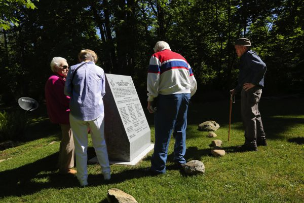 Checking out the new granite memorial are Rosa Echaniz Facciuto, left, class of 1936; Pat Sullivan Rosenkranz, class of 1949; Emil Martin, class of 1940; and Ron Munro, whose wife (Miriam), graduated from Cleveland in 1950. (Alan Berner/The Seattle Times)